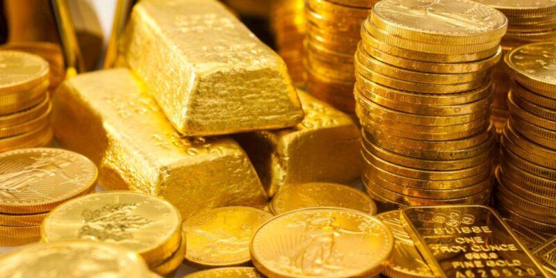 lingotti e monete di oro puro